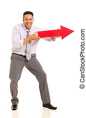 middle aged man pointing with arrow sign