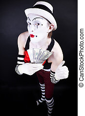 funny mime in white hat and gloves, holding a stack of hundred-dollar bills