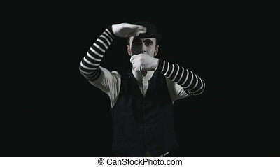 Funny mime performing a pantomime - Young funny mime...