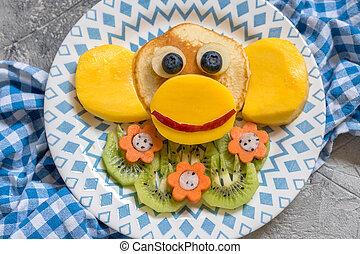 Funny monkey pancakes for kids breakfast
