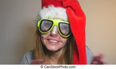 Funny office woman in Santa hat with inflatable ring