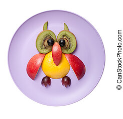 Funny owl made of fruits on purple plate