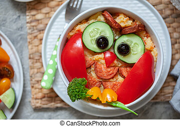 Funny owl mashed potato carrot vegetable puree with sausage