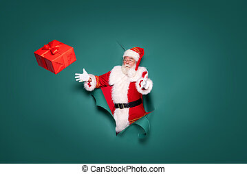 Funny photo of real Santa Claus with gift