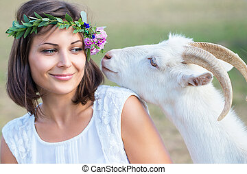 Funny picture a beautiful young girl farmer with a wreath on...