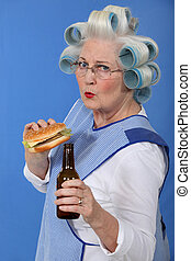funny picture of grandma with hair curlers relishing...