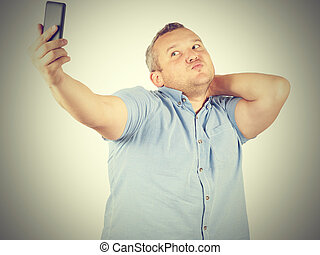 Funny picture of  plump man  businessman doing selfie.
