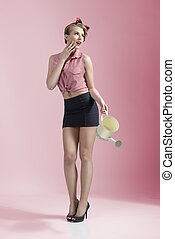 funny pin-up female gardener - sensual blonde girl with...