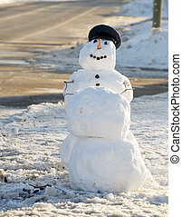 """Humorous image of a policeman snowman who has taken down the """"bad guy"""" snowman."""