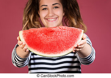 Funny portrait happy smiling young woman holding slice of watermelon