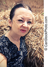 funny portrait of a girl with straw