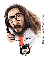 Funny portrait of a nerdt guy talking on the phone