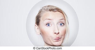 Funny portrait of blonde girl