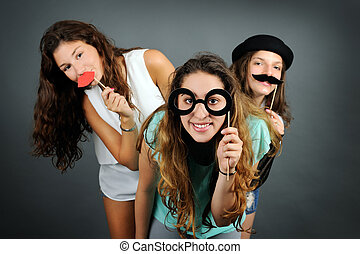 Funny portrait - Portrait of playful girls on grey...