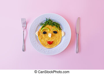 Funny prepared omelette with human face shape for kids