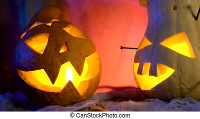 Funny pumpkin head the company during the night Halloween. sinister composition but lovely holiday attributes.