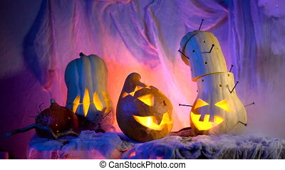 Funny pumpkin head the company during the night Halloween. ...