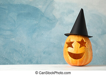 Funny pumpkin on white wooden background, space for text