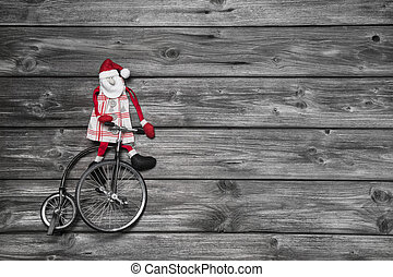 Funny red santa claus on wooden grey background in hurry for buy