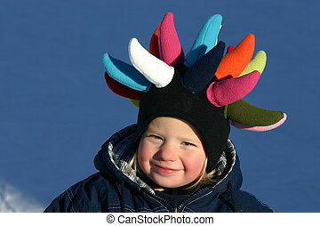 funny reindeer - little girl with warm and funny cap in the...