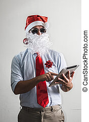 funny santa claus babbo natale using tablet on white...