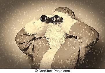 Funny Santa Claus have a fun with binoculars