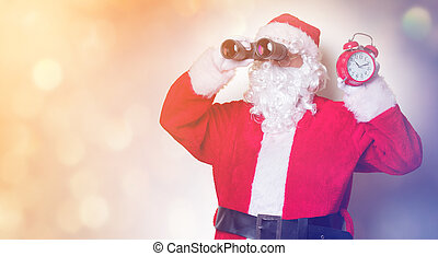 Santa Claus holding binoculars and alarm clock
