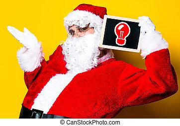 Funny Santa Claus holding black board
