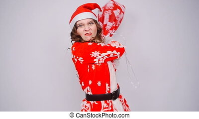 Funny santa woman with bag of gifts