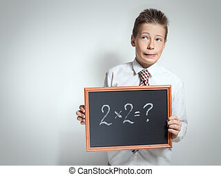 Funny schoolboy has thought of the task decision - The cute...