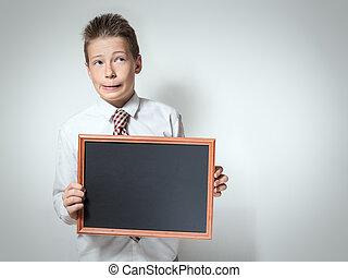 Funny schoolboy with empty chalkboard