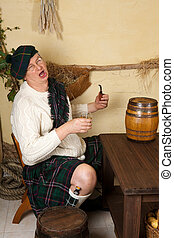 Funny Scotsman drinking whisky - Funny Scottish man in a pub...