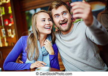 Funny selfie - Ecstatic young couple taking their selfie