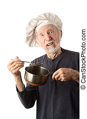 Funny senior chef with big white hat and pot of beans