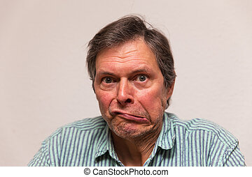 funny senior making a grimace