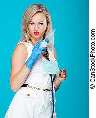 Funny sexy girl doctor nurse with syringe stethoscope....