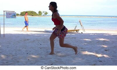 Funny sexy girl playing beach volleyball.