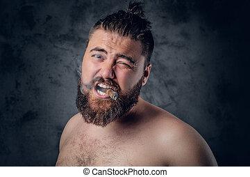 Funny shirtless bearded male smoking a cigar.