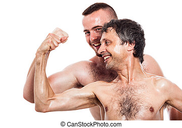 Funny shirtless men compare biceps