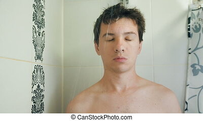 Funny sleeping man taking a shower