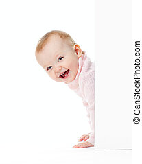 funny smiling girl look out of wall
