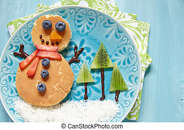 Funny snowman Christmas morning breakfast pancakes for kids