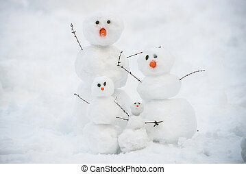 Funny snowman family