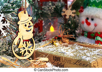funny snowmen with Christmas presents on the background of a red lantern and New Year's decorations