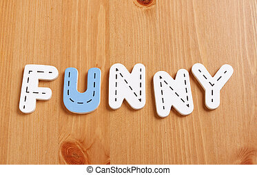 FUNNY, spell by woody puzzle letters with woody background