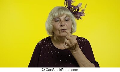Funny stupid senior old woman picking nose with silly ...