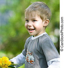 funny summer - Happy kid with dandelions in summer park