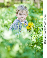 Funny summer - Happy little kid with dandelions in summer...