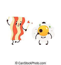 Funny sunny side up egg and fried bacon strip