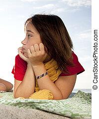 Funny teen girl at beach